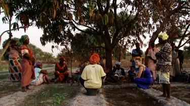 Women gathering in the community garden