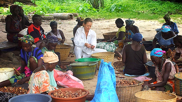 Women sorting nuts in a village, Guinea-Bissau