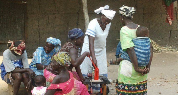 Women testing oil expeller